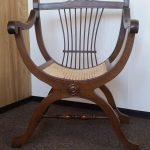Antique bow bottomed cane seated chair